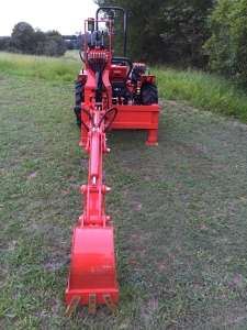 Backhoe attachment on AGT850 Hillside Tractor